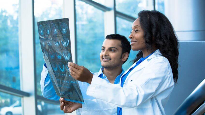 doctors looking at x-ray charts