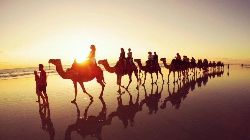 Sunset camel safari along Cable Beach in Western Australia.