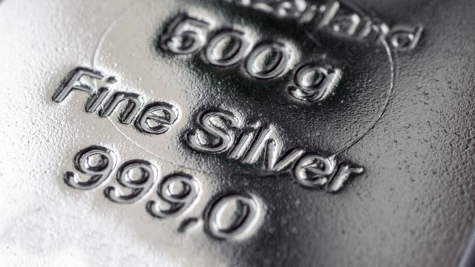 The surface of cast silver bullion. The texture of the surface of the silver bar. Selective focus. (shallow DOF)