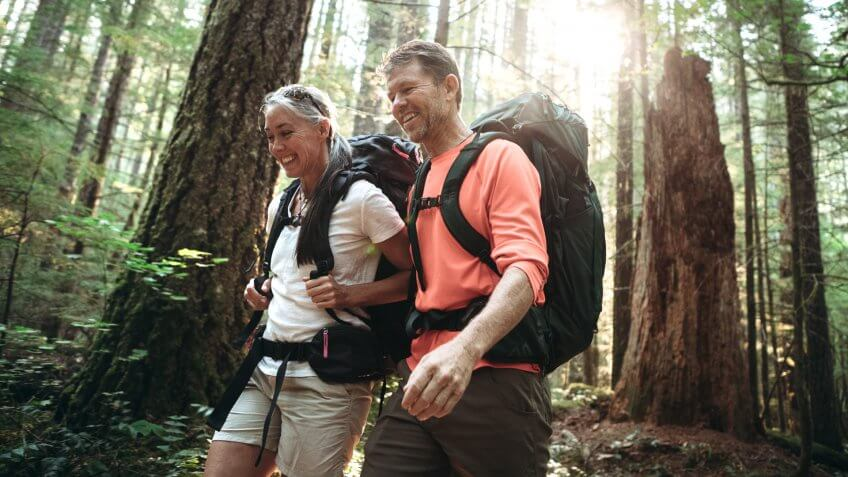 A couple in their mid- 50's enjoy an extended hike in the Pacific Northwest.