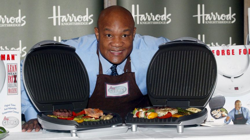 GEORGE FOREMAN SOME MEAT ON 'BIG GEORGE' - THE LATEST ADDITION TO HIS LEAN MEAN FAT REDUCING GRILLING RANGEGEORGE FOREMAN LAUNCHING 'BIG GEORGE', HARRODS, LONDON, BRITAIN - 12 NOV 2002.