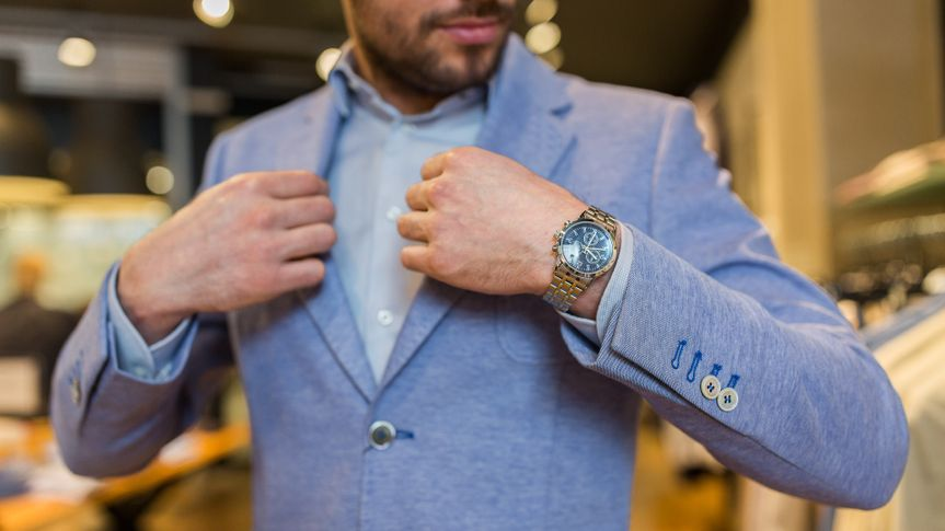 man-trying-on-suit-and-watch