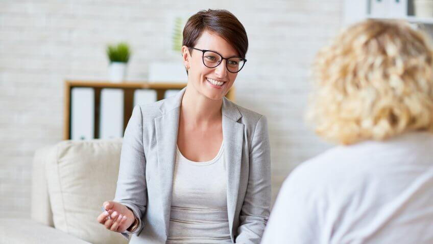 Successful psychologist talking to her patient.