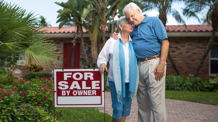 Senior couple selling their big house, bad times with the economy.
