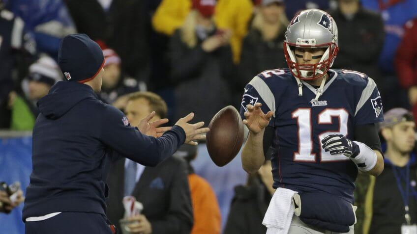 Mandatory Credit: Photo by Matt Slocum/AP/REX/Shutterstock (6015047a)New England Patriots quarterback Tom Brady has a ball tossed to him during warmups before the NFL football AFC Championship game against the Indianapolis Colts in Foxborough, Mass.