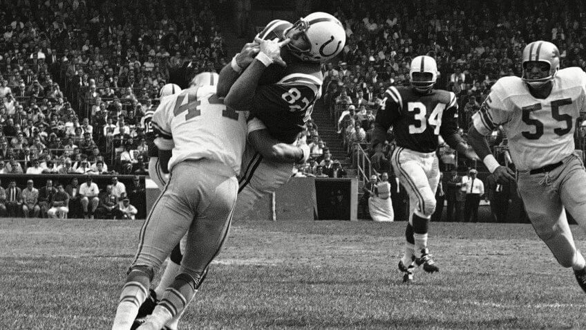 Mandatory Credit: Photo by Uncredited/AP/REX/Shutterstock (6030592a)Baltimore Colts end Raymond Berry snags a pass from quarterback John Unitas for 5-yard gain against the Detroit Lions in a football game in Baltimore.