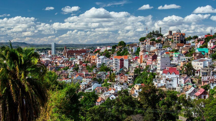 City of Antananarivo at sunny day with fluffy clouds in the sky.