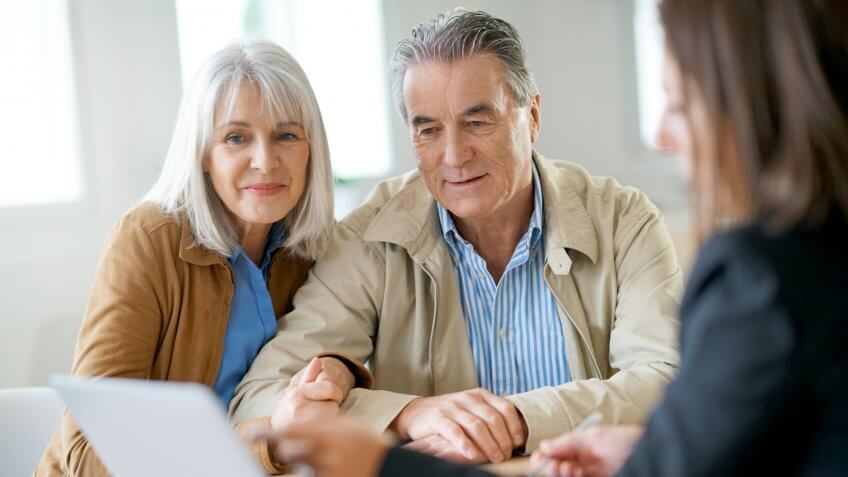 retirees talking to a financial expert