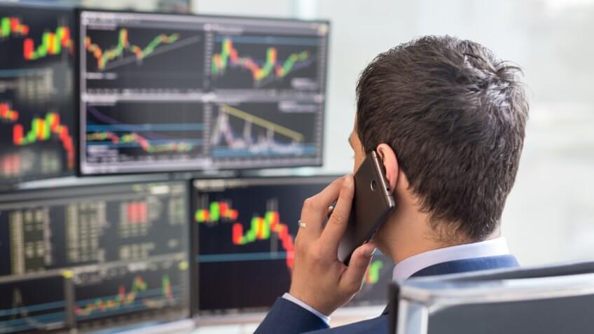 stock broker talking on phone trading stocks