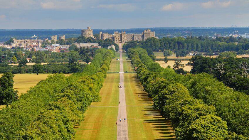 The Long Walk in Windsor Great Park in England with Windsor Castle in the background.