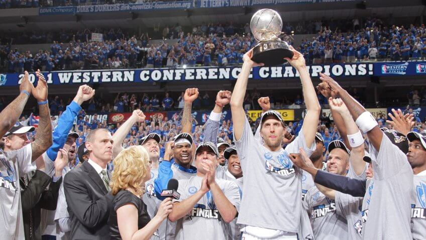 DALLAS, TX - MAY 25: Dirk Nowitzki #41 holds up the trophy in celebration with owner Mark Cuban and the Dallas Mavericks as they celebrate their victory against the Oklahoma City Thunder during Game Five of the Western Conference Finals in the 2011 NBA Playoffs on May 25, 2011 at the American Airlines Center in Dallas, Texas.