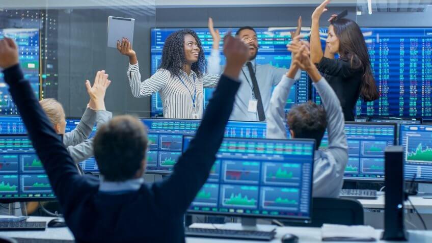 team of investors cheering