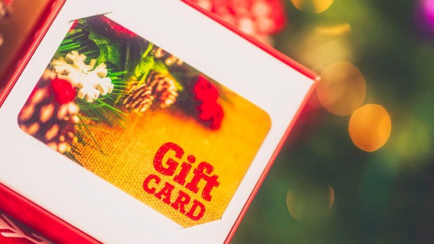 Christmas gift card in opened box in Christmas setting