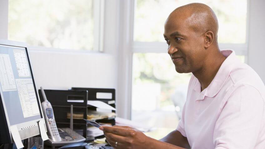man-paying-credit-card
