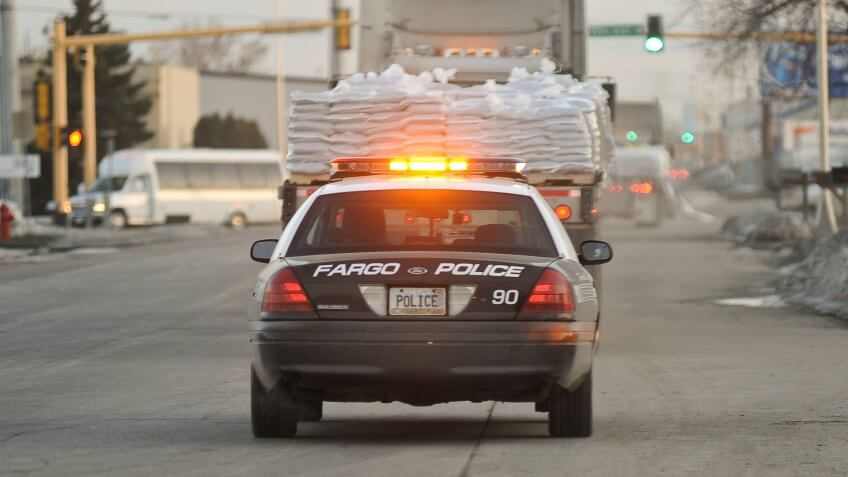 As the Red River rises to major flodd stage Fargo Police help deliever sand bags to where they are needed.