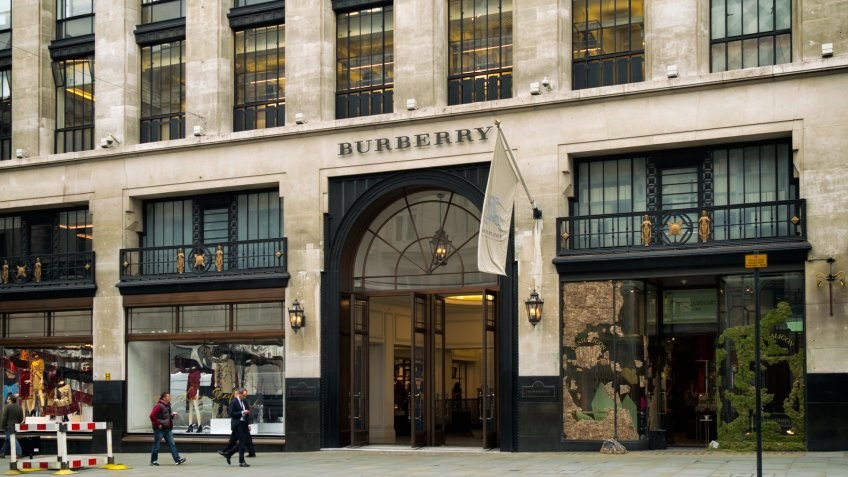 London, England - September 8, 2015: A few people walking past the Burberry store in Regent Street, Central London, on an overcast day.