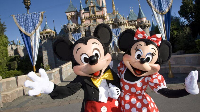 MICKEY & MINNIE -- Standing in front of Sleeping Beauty Castle at Disneyland, where magical storybooks come alive, Mickey Mouse and Minnie Mouse welcome visitors from all over the world.