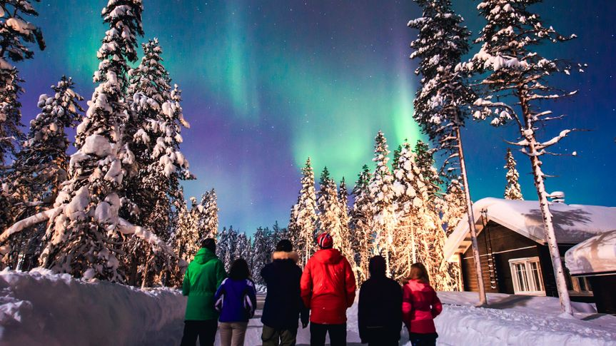 Beautiful picture of massive multicolored green vibrant Aurora Borealis, Aurora Polaris, also know as Northern Lights in the night sky over winter Lapland landscape, Norway, Scandinavia.