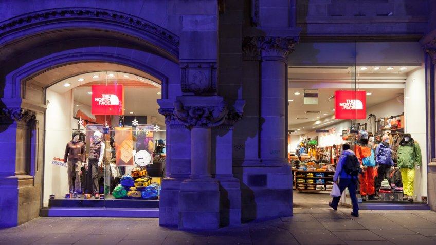 """Glasgow, Scotland, UK - 18th November, 2012: A shopper walks into The North Face shop in Buchanan Street, Glasgow."