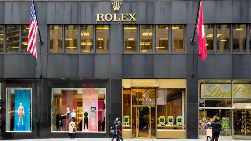 New York City, New York, USA - March 14, 2014: Rolex Store on fashionable Fifth Avenue in Manhattan with pedestrians visible.