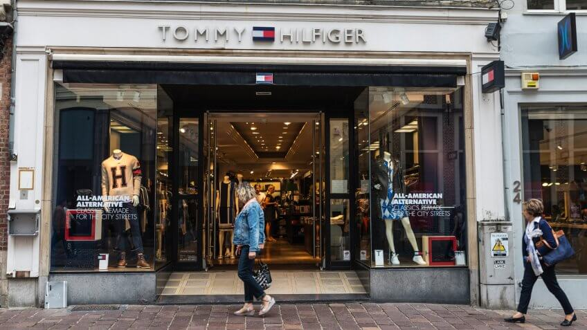 Bruges, Belgium - August 31, 2017: Tommy Hilfiger shop with people around in the historic center of Bruges, Belgium.