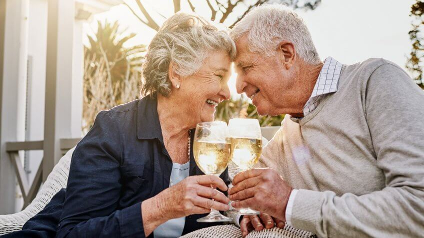 senior couple toasting with wine