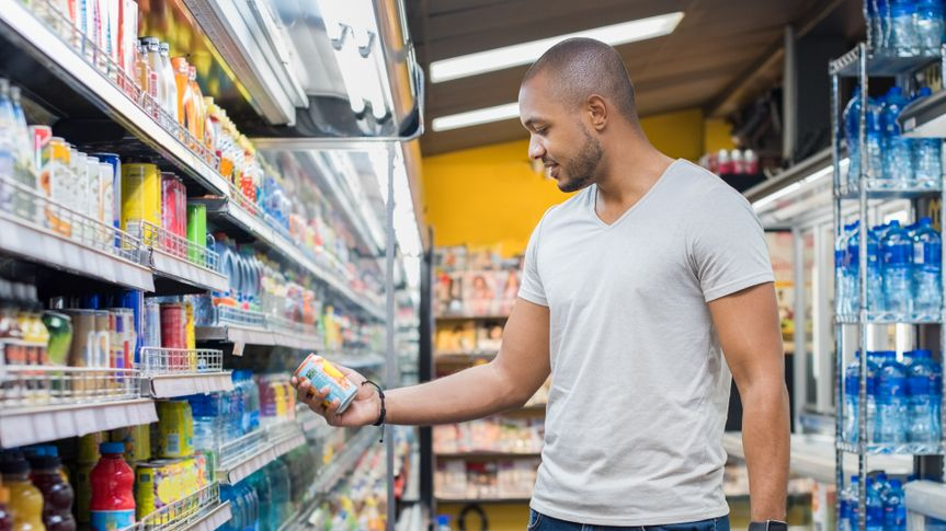 Man shopping in beverage section at supermarket.