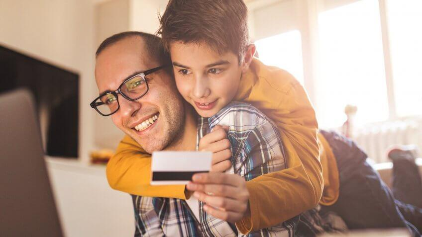 Photo of father with son on line shpping.