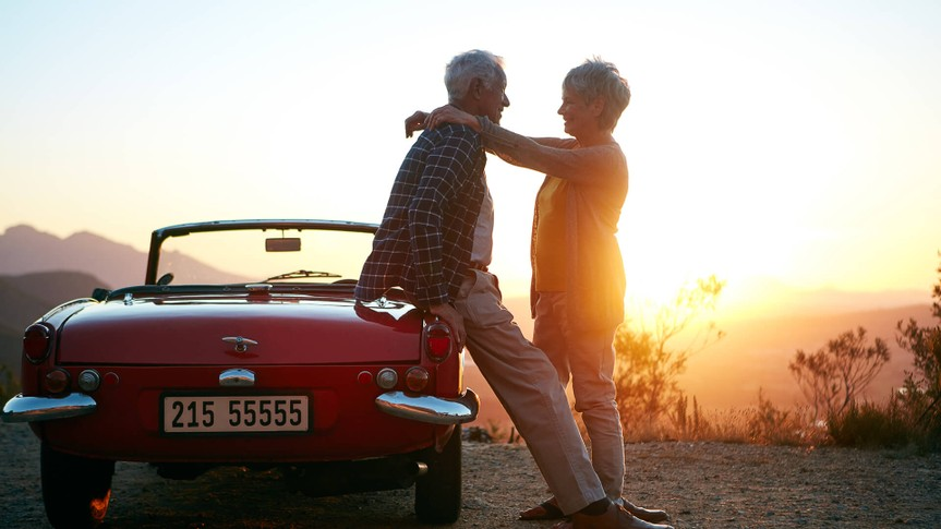 Shot of an affectionate senior couple enjoying the sunset during a roadtrip.