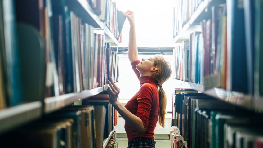 grabbing book in library