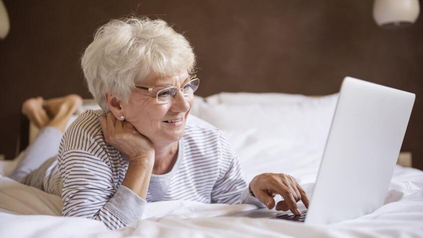Computer, bed, elderly, laptop, senior, woman