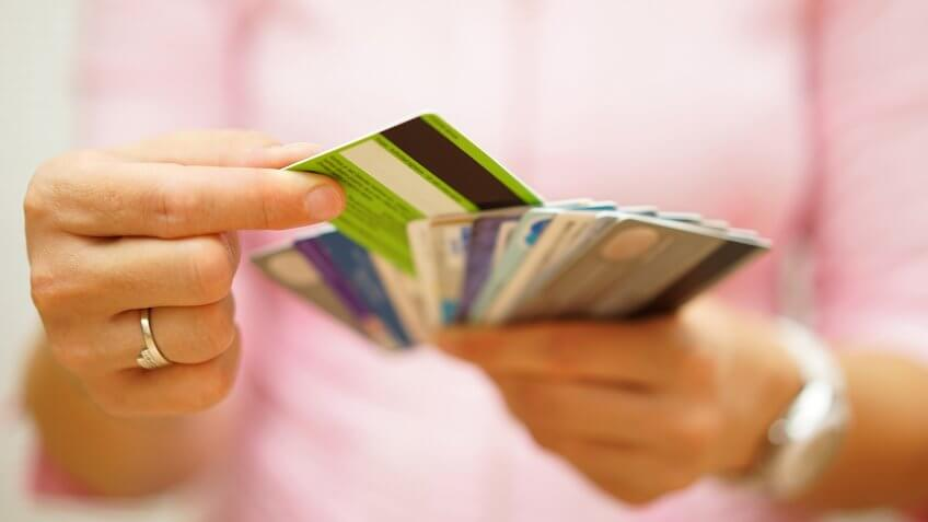 woman choose one credit card from many, concept of credit card debt