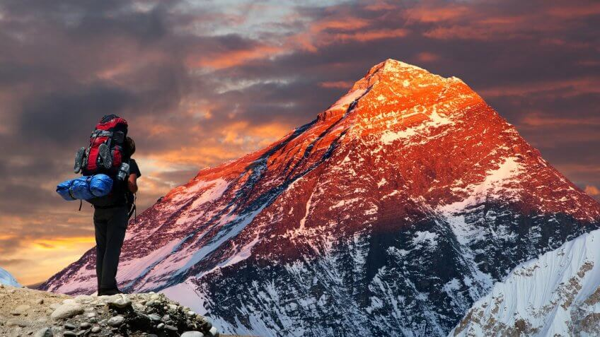 Evening colored view of Mount Everest from Gokyo valley with tourist on the way to Everest base camp, Sagarmatha national park, Khumbu valley, Nepal.
