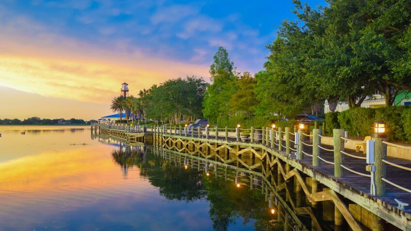 Sunset on the boardwalk on the waterfront at The Villages, Florida.