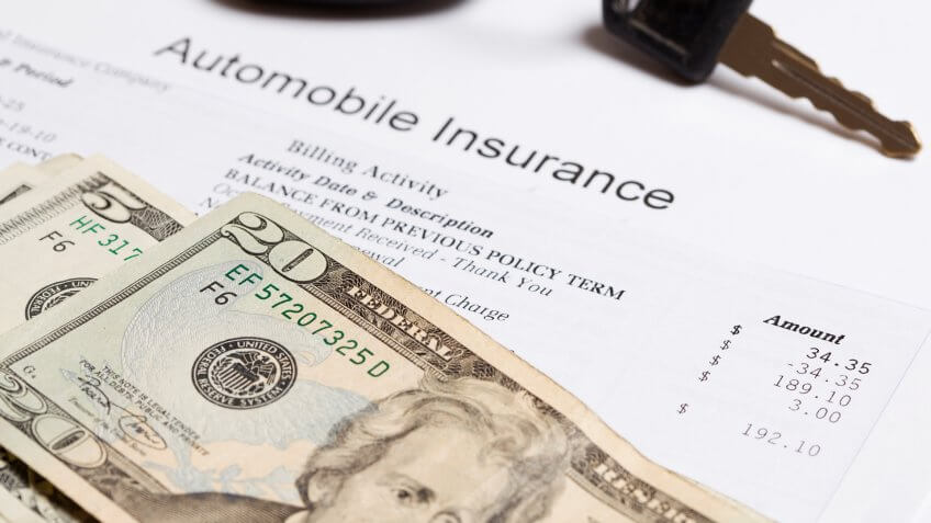 keys, money, and an auto insurance bill.