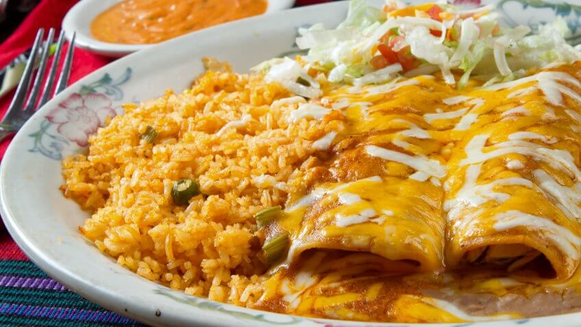 Hot, gooey and cheesy cheese enchiladas in a Mexican restaurant.
