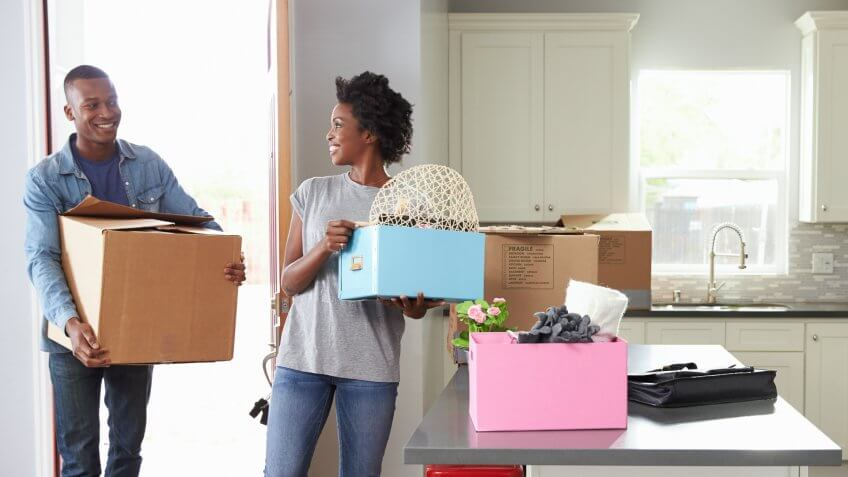 Young Couple Moving In To New Home Together.