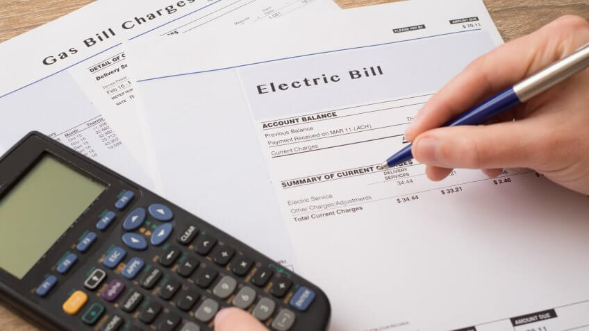 Electric bill charges paper form on the table.