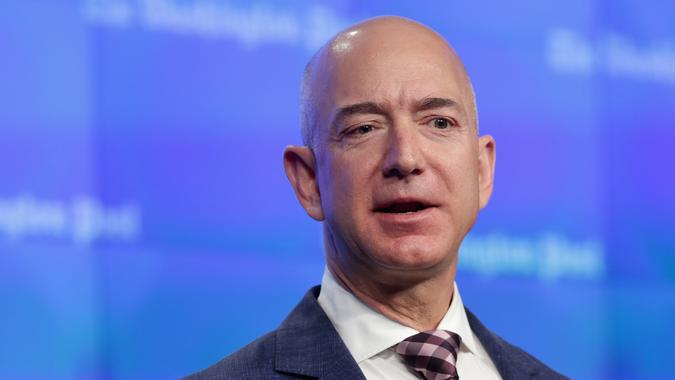 WASHINGTON, DC - JANUARY 28:  Amazon founder and Washington Post owner Jeff Bezos delivers remarks during the opening ceremony of the media company's new location January 28, 2016 in Washington, DC.