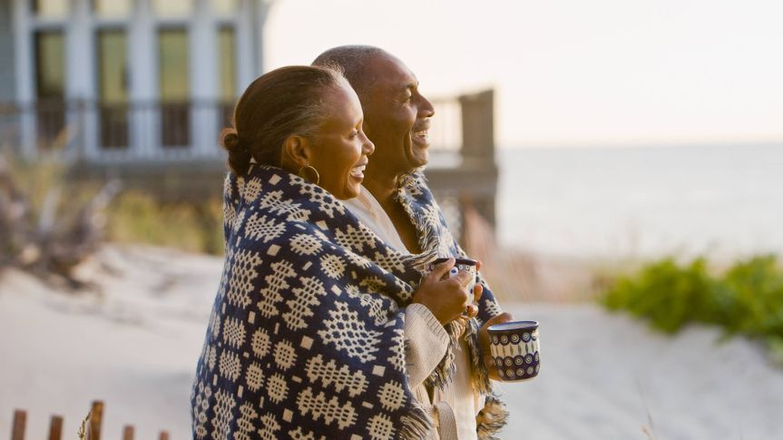 60-65 years, 65-70 years, Beach, Blanket, Boyfriend, Coffee, Color Image, Copy Space, Couple, Family, Food And Drink, Girlfriend, House, Husband, Laughing, Leisure Activity, Love, Mug, Outdoors, Photography, Relaxation, Senior Adult, Side View, Smiling, Standing, Sunrise, Sunset, Travel, Two People, Waist Up, Weekend Activities, Wife, anniversary, babyboomer, cuddling, enjoying, friend, happy, man, men and women, nature, ocean, people, profile, recreation, resort, retirement, romance, together, vacation, woman