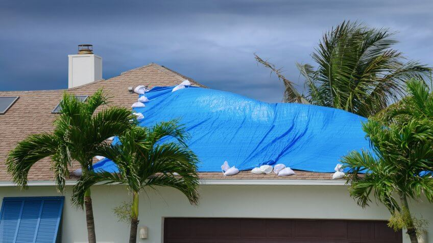 storm-damaged-roof-on-house-protective