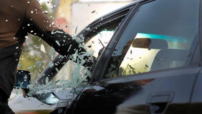 man-breaking-cars-window-million-pieces