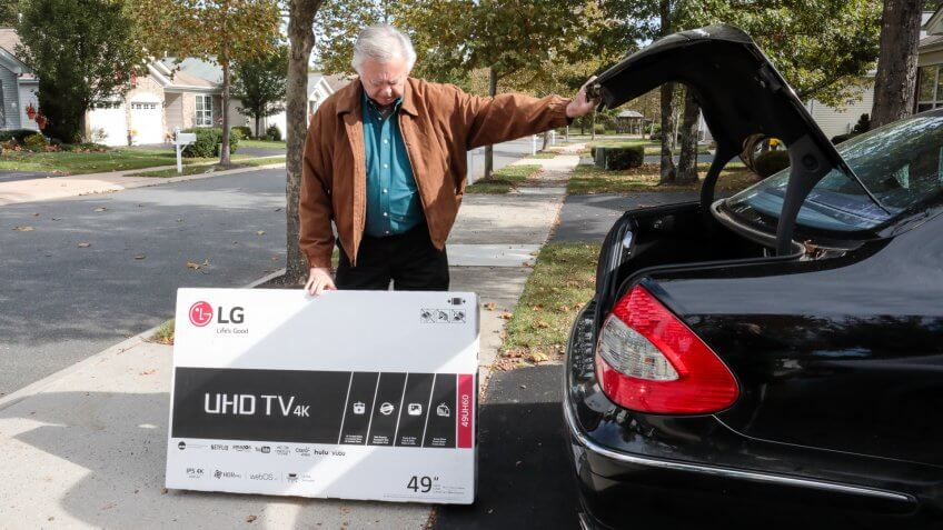 Galloway, United States - October 26, 2016: Series:Senior caucasian man has bought a new flat screen tv for his home.