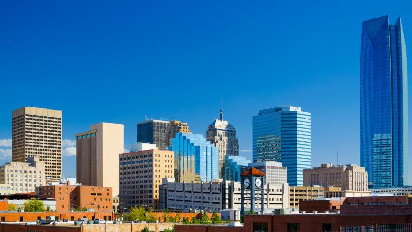 Oklahoma downtown skyline with a deep blue sky, featuring the new Devon Energy Center building.