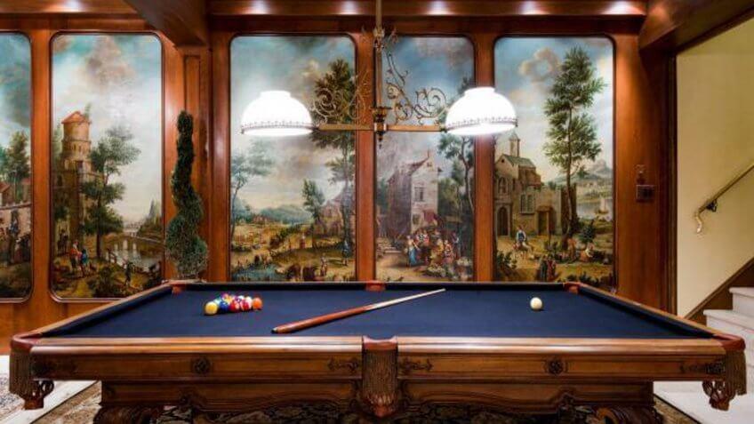 full length wall art behind a pool table