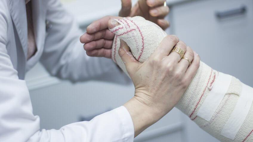 doctor-applying-plaster-cast-bandages-patient