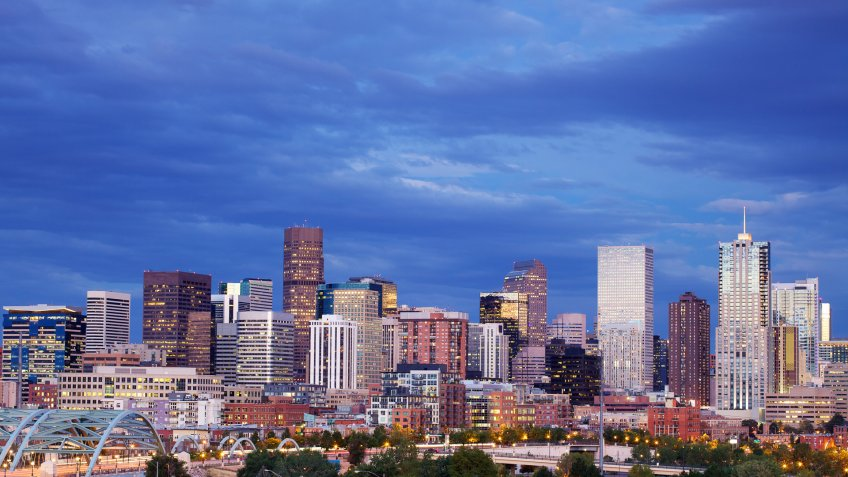 The skyscrapers in the skyline of Denver, Colorado at sunset.