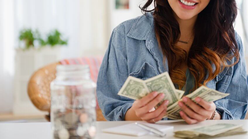 young woman counting cash