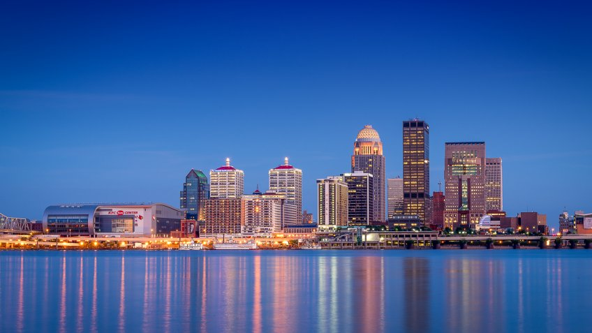 looking across the river just after sunset at the Louisville, Kentucky skyline.
