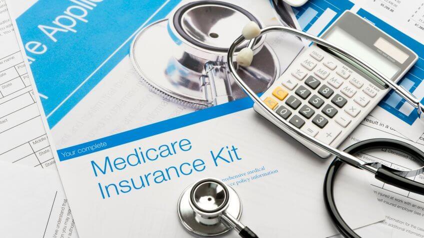Medicare brochure with paperwork.